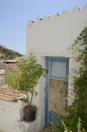 Old blue door at whitewashed traditional house  in Casares, a mountain Andalusian white village of Malaga province, Andalusia, Spain.