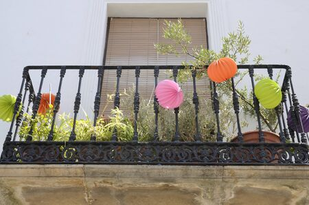 Color lanterns on balcony in Casares, a  mountain village of Malaga province, Andalusia, Spain. Stock fotó