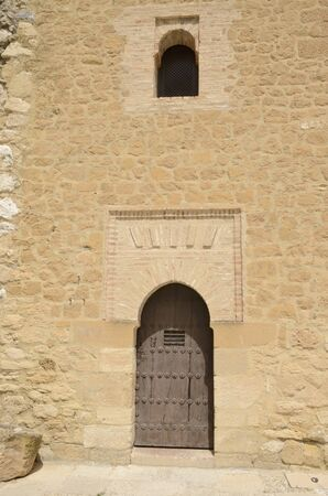 Arab style door on stone wall  in Antequera, a city of the province of Malaga, Andalusia, Spain. Foto de archivo - 131834457