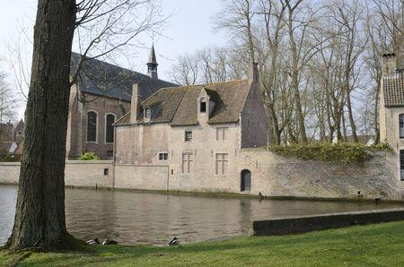 Brick buildings along canal in Brugge, West Flanders,Belgium.