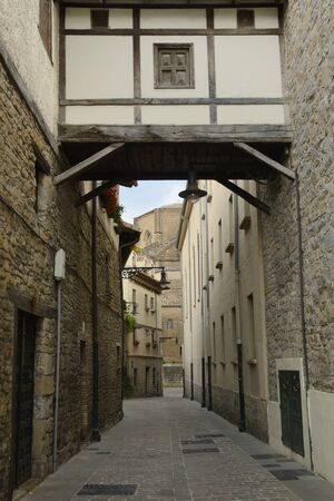 Passage at picturesque alley in the old town of Pamplona, the capital of the Navarre Community, Spain.