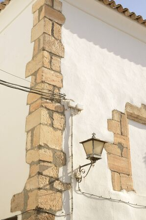 Stone detail of white building corner in the village of Belmonte, province of Cuenca, Spain.