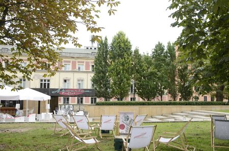 Warsaw, Poland - July 29, 2018: Seats on grass at terrace bar in central street  of Warsaw, Poland.