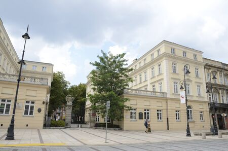 Warsaw, Poland - July 29, 2018: Couple walking by main avenue of Warsaw, the capital of Poland.