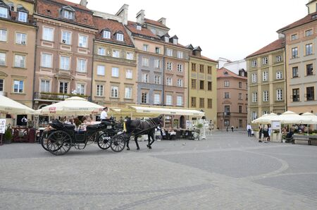 Warsaw, Poland - July 30, 2018: Horse carriage at the picturesque Market Square in the old town of Warsaw, Poland.