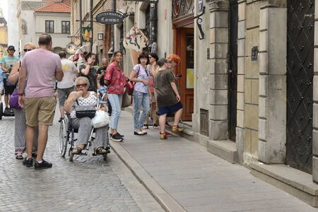 Warsaw, Poland - July 29, 2018: People at cobbled street in the old town of Warsaw, Poland.