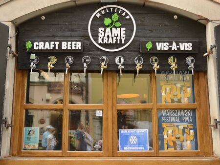 Warsaw, Poland - July 29, 2018: Window display of beer bar in the old town of Warsaw, Poland.
