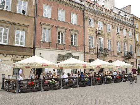 Warsaw, Poland - July 29, 2018: People at terrace of bar in cobbled street of the old town of Warsaw, Poland.