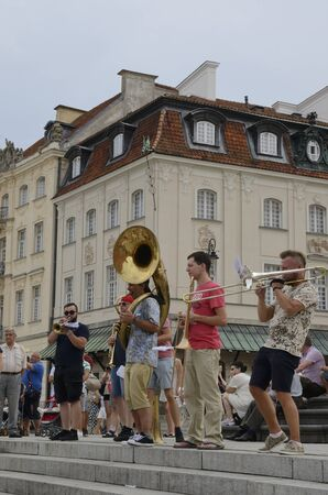 Warsaw, Poland - July 29, 2018: Musicians  in the famous Square of the castle  in Warsaw, Poland.
