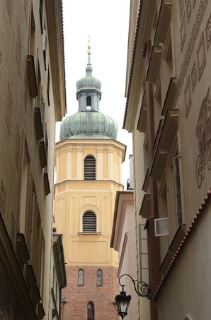 Tower at alley  in the old town of  Warsaw, Poland.