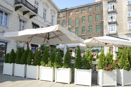 Warsaw, Poland - July 30, 2018: Outdoor terrace of restaurant in Threee Crosses Square in the  Royal Route  of Warsaw, Poland.