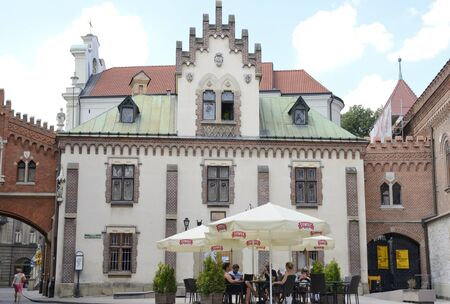 Krakow, Poland - July 25, 2018: People at exterior bar in the old town of Krakow, Poland.