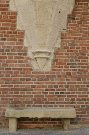 Stone bench on brick wall in  Krakow, Poland. 版權商用圖片