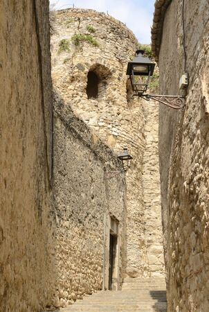 Tower at cobblestone alley in the Jewish quarter of Girona,  Catalonia, northeastern Spain.