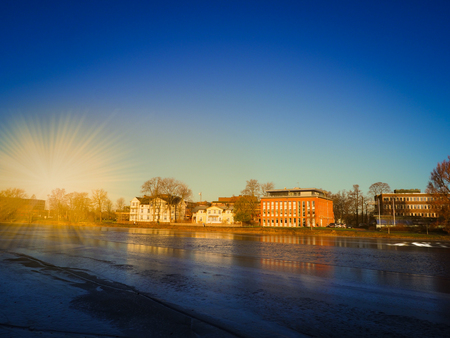 karlstad: Cityscape near the river in winter season with gold light and navy blue sky background, Karlstad, Sweden Stock Photo