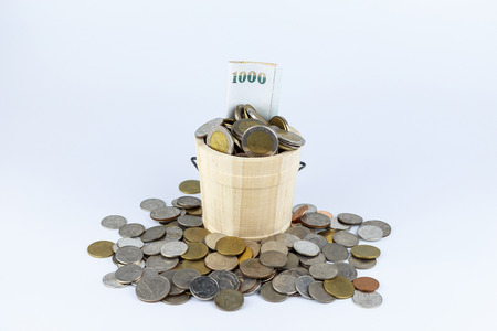 bucket of money: Accumulate funds for investment Stock Photo