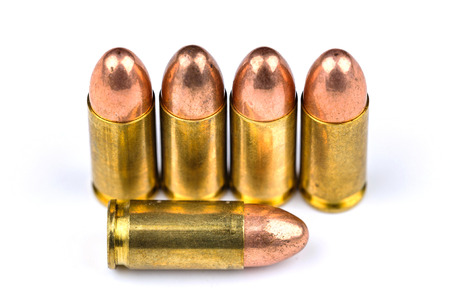 9mm ammo: A group of 9mm bullets for a a gun isolated on a white background