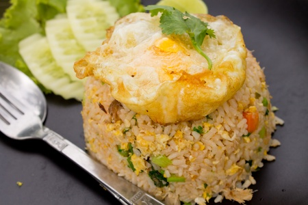 Crab fried rice with fried egg photo