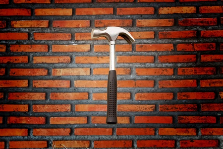 Brick walls and a hammer Stock Photo - 9910681