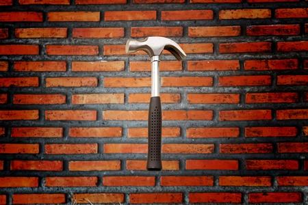 Brick walls and a hammer Stock Photo - 9910681