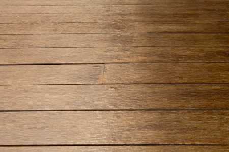 table surface: Parquet flooring is brown