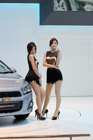 BANGKOK, THAILAND - MARCH 28   An unidentified female presenter present at Chevrolet booth  in the Thailand International Motor show 2012 at IMPACT on March 28, 2012 in Bangkok, Thailand  Stock Photo - 12903888