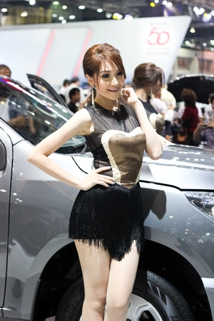BANGKOK, THAILAND - MARCH 28   An unidentified female presenter present at Chevrolet booth  in the Thailand International Motor show 2012 at IMPACT on March 28, 2012 in Bangkok, Thailand