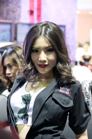 BANGKOK, THAILAND - MARCH 28 : An unidentified female presenter present at Mini Cooper booth in the Thailand International Motor show 2012 at IMPACT on March 28 - April 8, 2012 in Bangkok, Thailand.