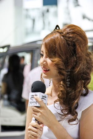 BANGKOK, THAILAND - MARCH 28 : An unidentified female presenter present at in the Thailand International Motor show 2012 at IMPACT on March 28, 2012 in Bangkok, Thailand.