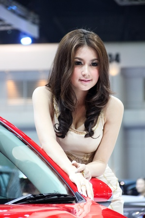 BANGKOK, THAILAND - MARCH 28 : An unidentified female presenter present at Mazda booth in the Thailand International Motor show 2012 at IMPACT on March 28, 2012 in Bangkok, Thailand.