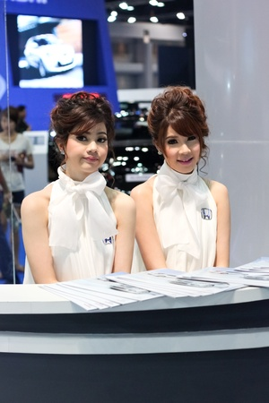 BANGKOK, THAILAND - MARCH 28 : An unidentified female presenter present at Honda booth in the Thailand International Motor show 2012 at IMPACT on March 28, 2012 in Bangkok, Thailand.