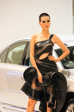 BANGKOK, THAILAND - MARCH 28 : An unidentified female presenter present at Volvo booth  in the Thailand International Motor show 2012 at IMPACT Muang Thong Thani on March 28, 2012 in Bangkok, Thailand.