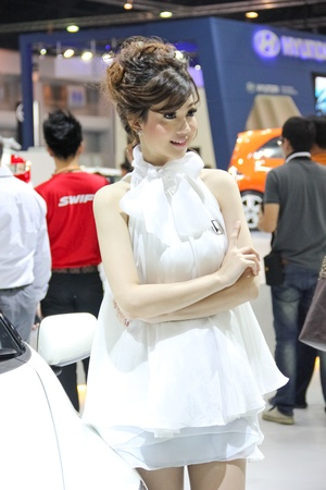 BANGKOK, THAILAND - MARCH 28 : An unidentified female presenter present at Honda booth  in the Thailand International Motor show 2012 at IMPACT Muang Thong Thani on March 28, 2012 in Bangkok, Thailand. Editorial