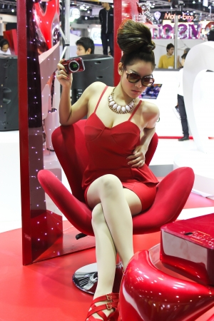 BANGKOK - DECEMBER 5  Unidentified female presenters model at the CANON booth during the Thailand International Motor Expo at Impact Muang Thong Thani on DECEMBER 5, 2012 in Bangkok, Thailand  Stock Photo - 17491328
