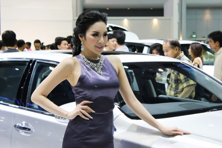 BANGKOK - DECEMBER 5  Unidentified female presenters model at the LEXUS booth during the Thailand International Motor Expo at Impact Muang Thong Thani on DECEMBER 5, 2012 in Bangkok, Thailand  Stock Photo - 17491286