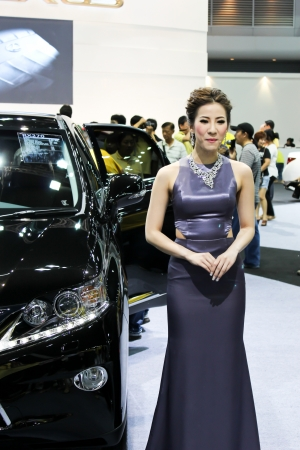 BANGKOK - DECEMBER 5  Unidentified female presenters model at the LEXUS booth during the Thailand International Motor Expo at Impact Muang Thong Thani on DECEMBER 5, 2012 in Bangkok, Thailand  Stock Photo - 17491290