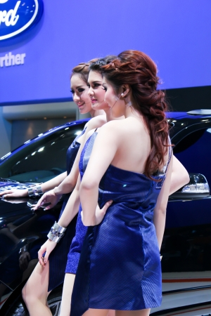 BANGKOK - DECEMBER 5  Unidentified female presenters model at the FORD booth during the Thailand International Motor Expo at Impact Muang Thong Thani on DECEMBER 5, 2012 in Bangkok, Thailand  Stock Photo - 17491295