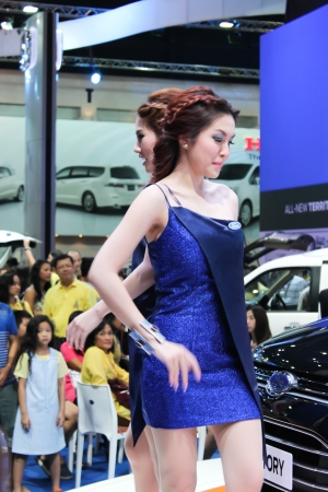 BANGKOK - DECEMBER 5  Unidentified female presenters model at the FORD booth during the Thailand International Motor Expo at Impact Muang Thong Thani on DECEMBER 5, 2012 in Bangkok, Thailand  Stock Photo - 17491291