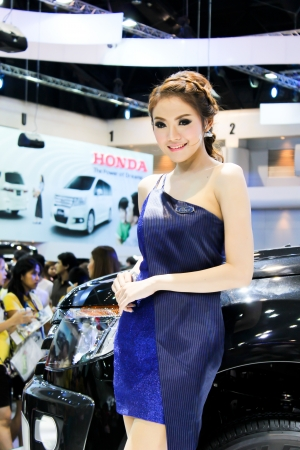 BANGKOK - DECEMBER 5  Unidentified female presenters model at the FORD booth during the Thailand International Motor Expo at Impact Muang Thong Thani on DECEMBER 5, 2012 in Bangkok, Thailand  Stock Photo - 17491284