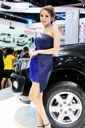 BANGKOK - DECEMBER 5  Unidentified female presenters model at the FORD booth during the Thailand International Motor Expo at Impact Muang Thong Thani on DECEMBER 5, 2012 in Bangkok, Thailand  Stock Photo - 17491298