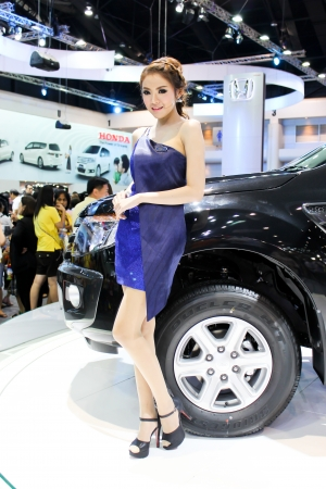 BANGKOK - DECEMBER 5  Unidentified female presenters model at the FORD booth during the Thailand International Motor Expo at Impact Muang Thong Thani on DECEMBER 5, 2012 in Bangkok, Thailand  Stock Photo - 17491292