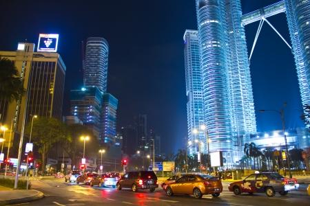 KUALA LUMPUR - DEC-31  View of The Petronas Twin Towers on DEC, 2012 in Kuala Lumpur, Malaysia  It is famous landmark of Malaysia  Petronas are the tallest twin buildings in the world