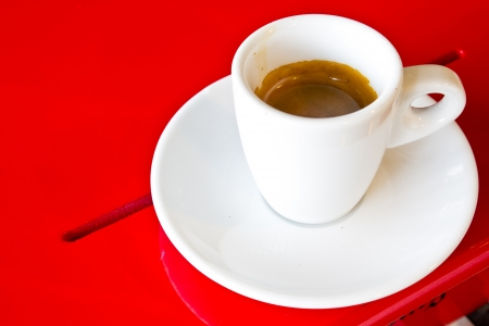 Coffee cup on red table photo