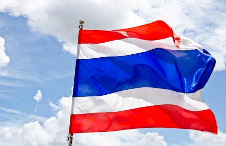 Waving Thai flag with blue sky background photo