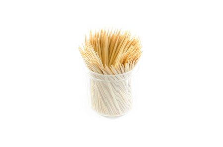 Wooden toothpicks isolated on white background photo