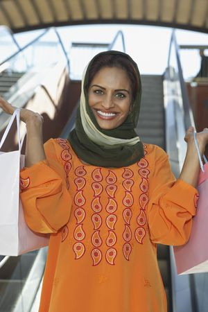Portrait of muslim woman with shopping bags Stock Photo - 3540919