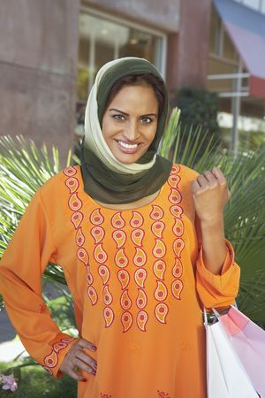 Portrait of muslim woman with shopping bags Stock Photo - 3540976
