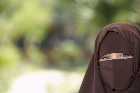 Portarit of young woman in brown niqab Stock Photo