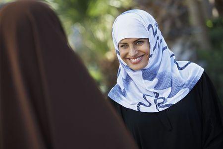 Two muslim woman talking Stock Photo - 3540737