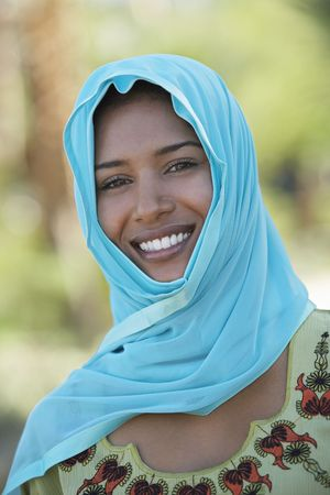 Portrait of muslim woman in blue headscarf, smiling Stock Photo - 3540875